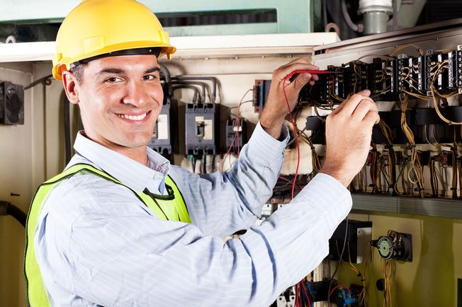 Electrician repairing a fuse board